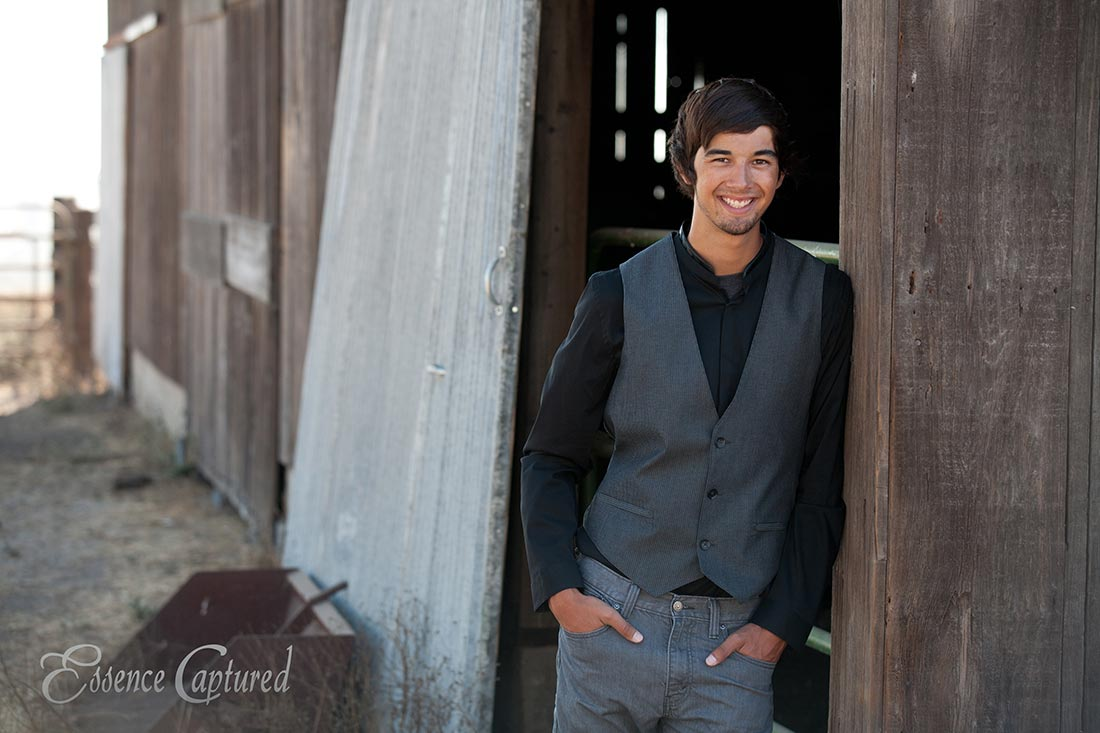 senior portrait male barn backdrop suit vest dark brown hair