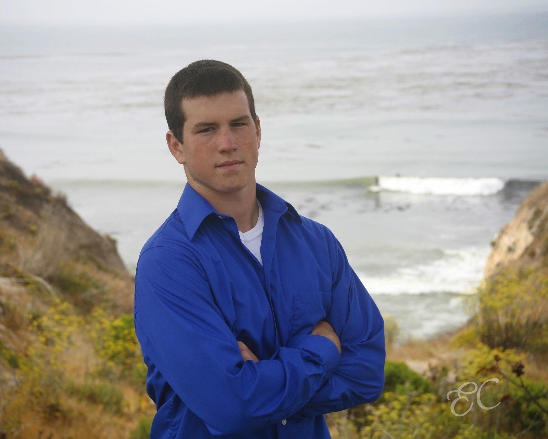 high school senior male royal blue long sleeve shirt ocean background