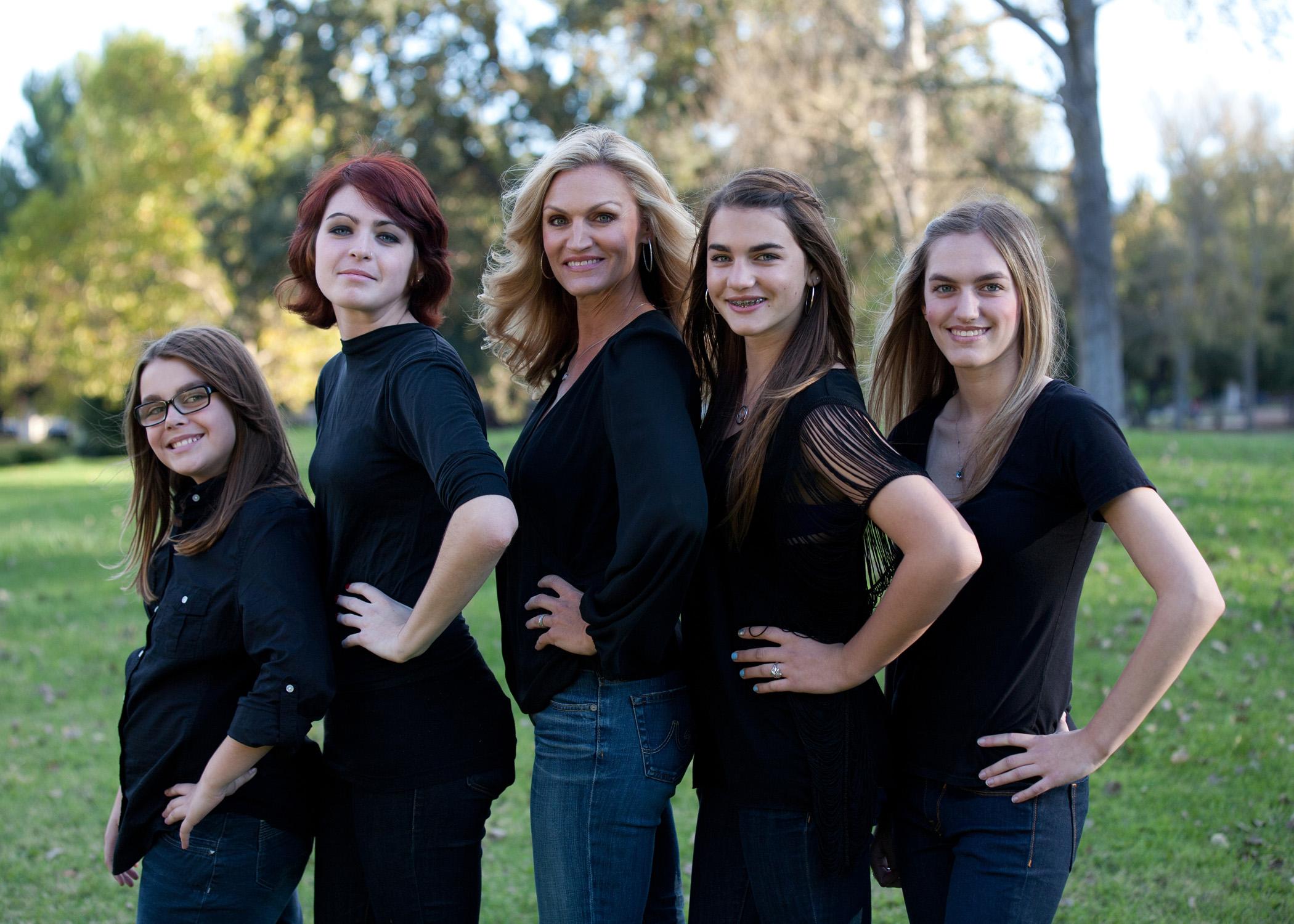 family portrait all 5 girls hands on hips