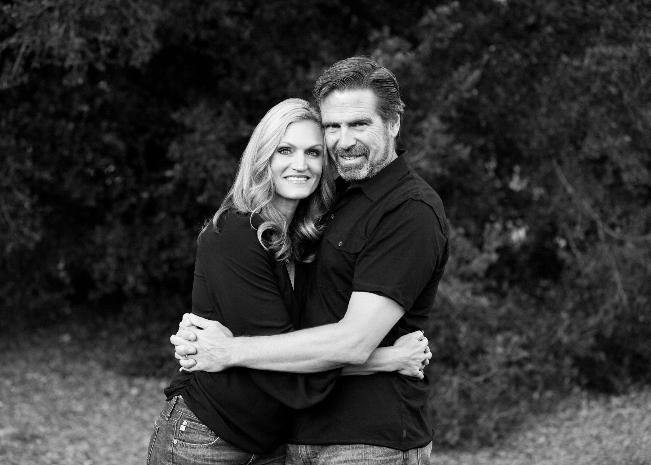 black and white couple portrait at park