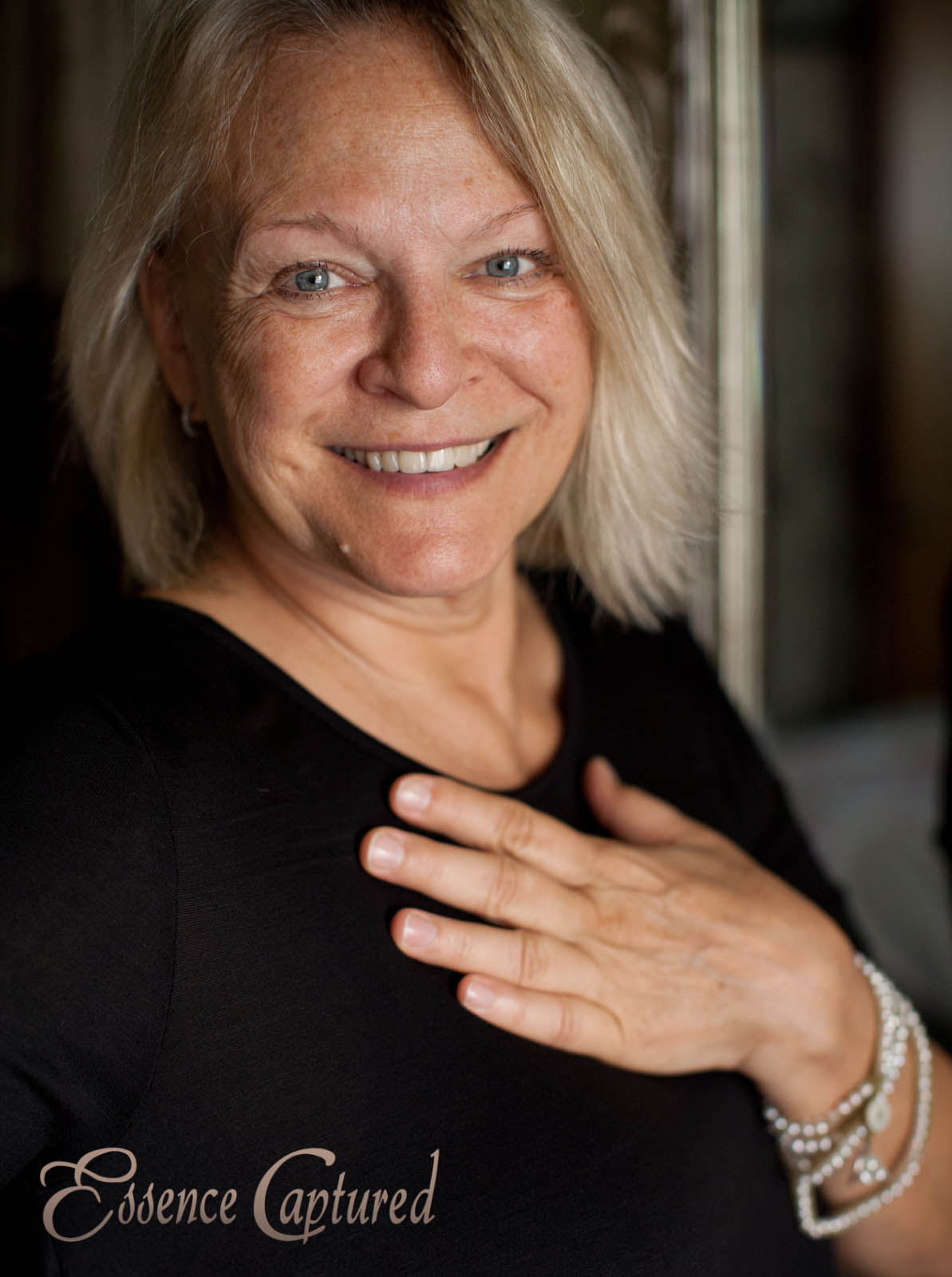 blonde older female headshot natural light