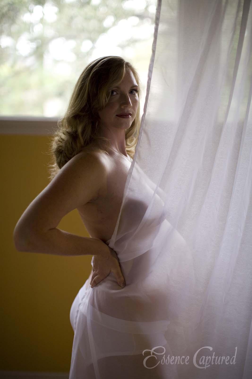 female maternity portrait back-lit sheer curtain