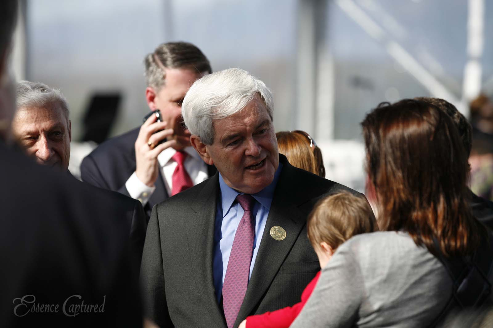 Newt Gingrich Former Speaker of the United States House of Representatives greets woman and baby at event