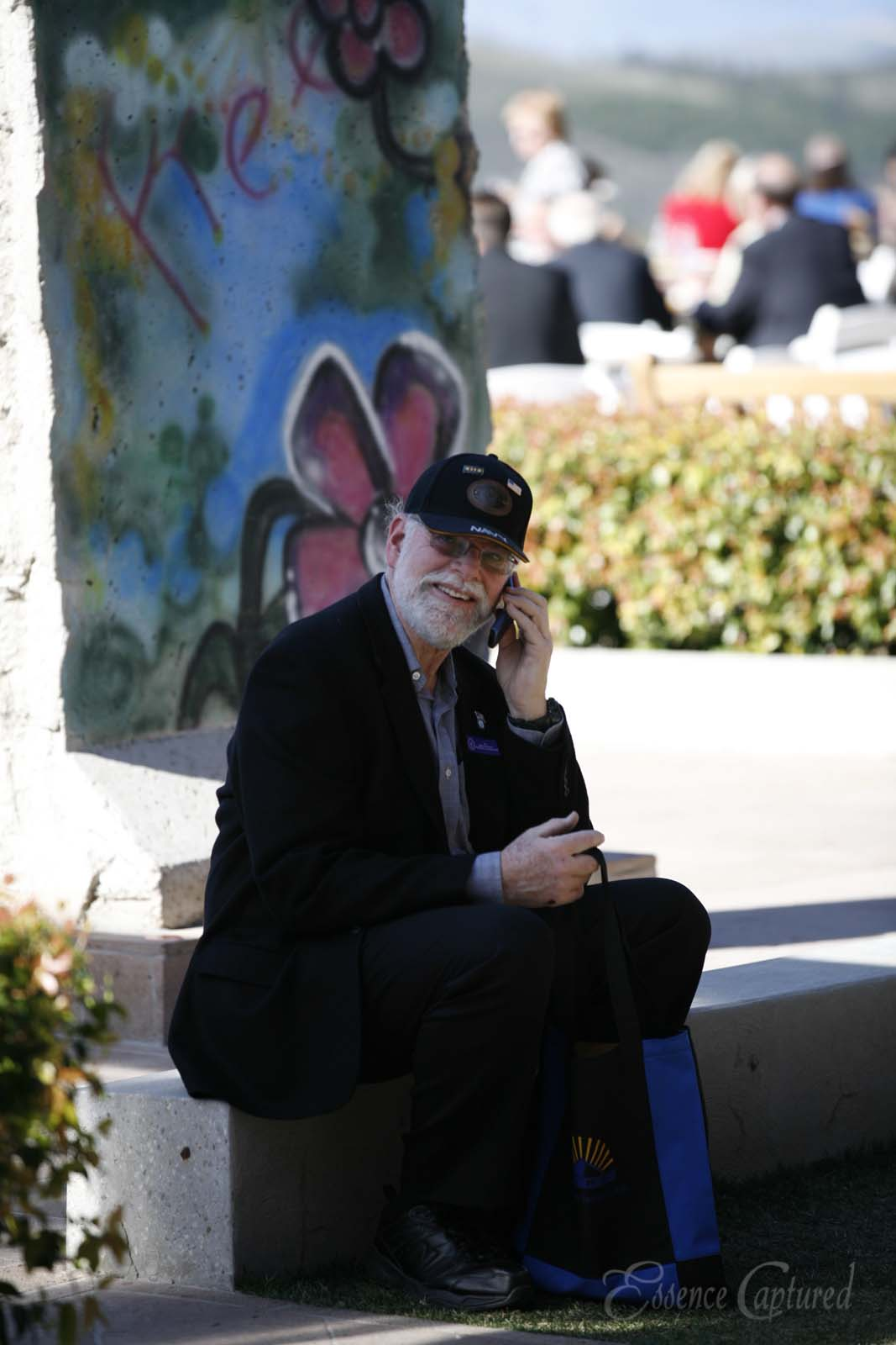 man on cell phone at event