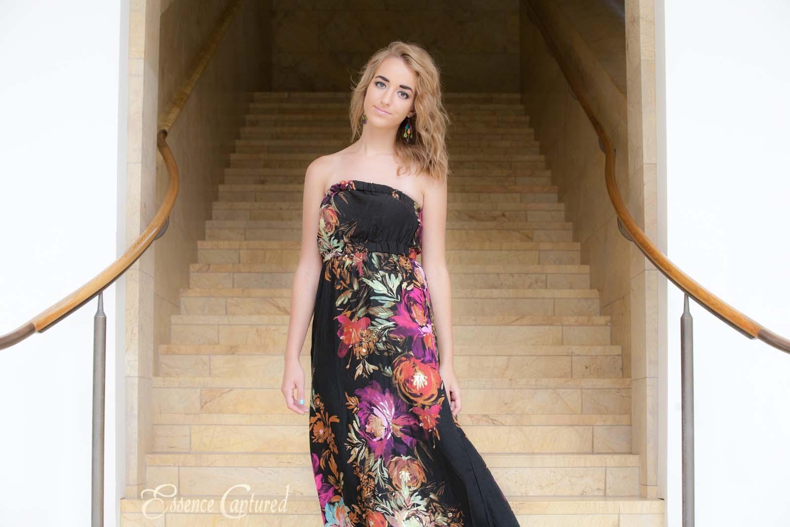 high school senior portrait female flowered print dress elegant stairway backdrop
