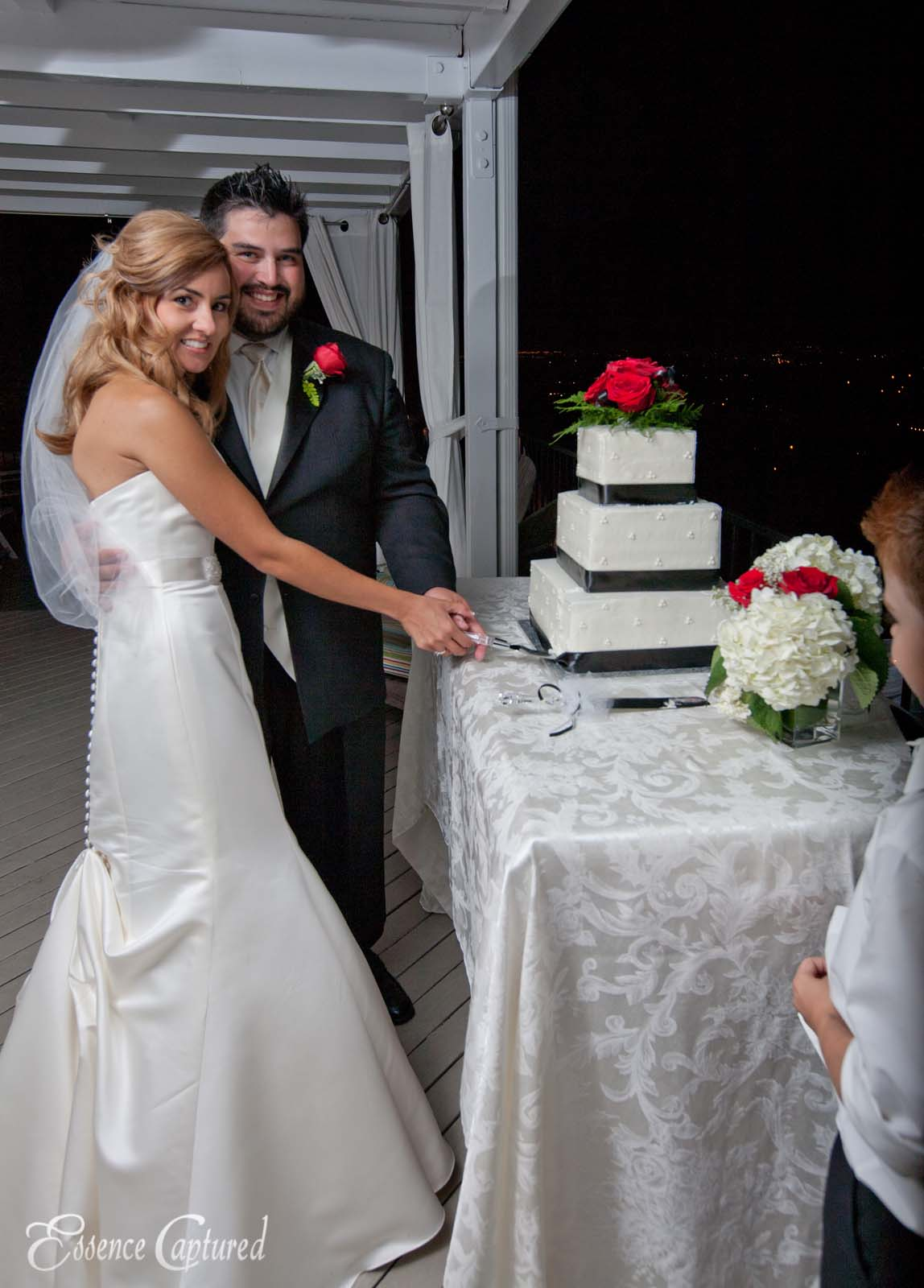 bride and groom cut the cake at wedding