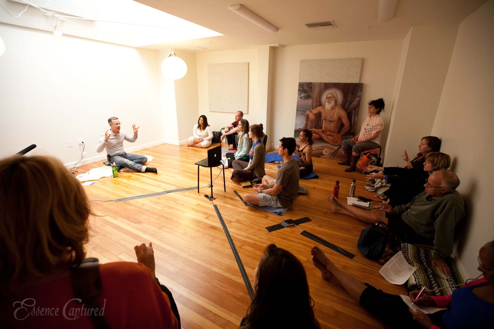instructor demonstrating mudras to students in yoga studio at Naam Yoga L.A.