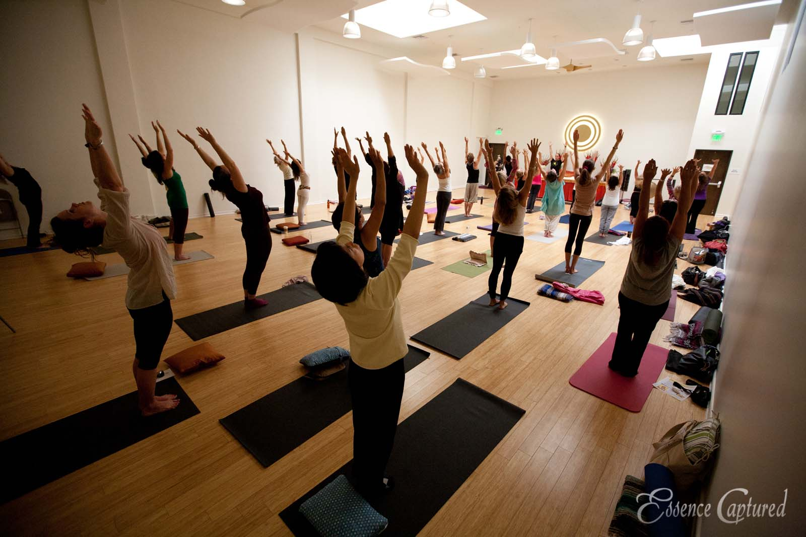 Shakti Naam class at Naam Yoga L.A. full class participation arms in the air arched backs