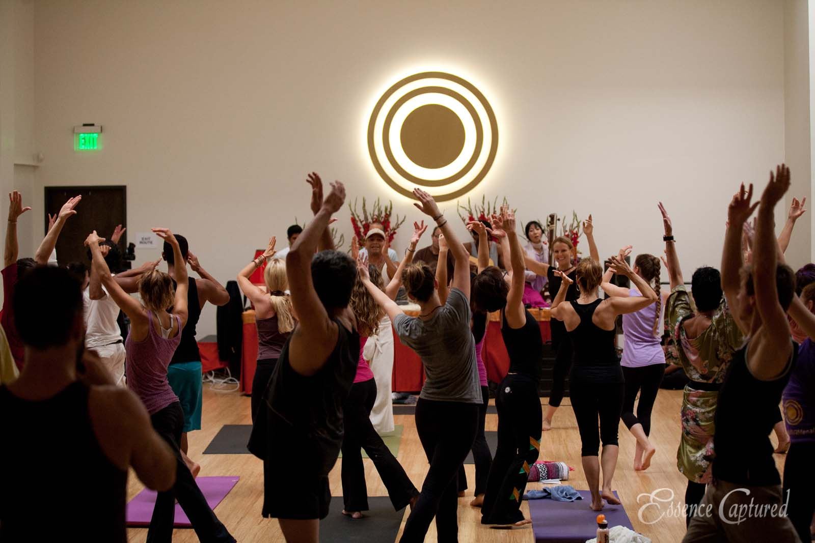 yoga class at Naam Yoga L.A. many students in motion