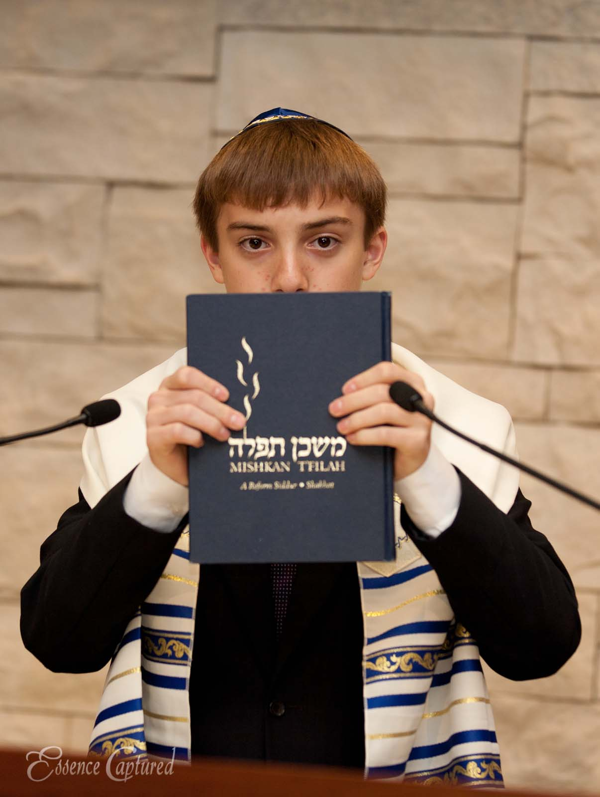 Bar Mitzvah boy shows reading book