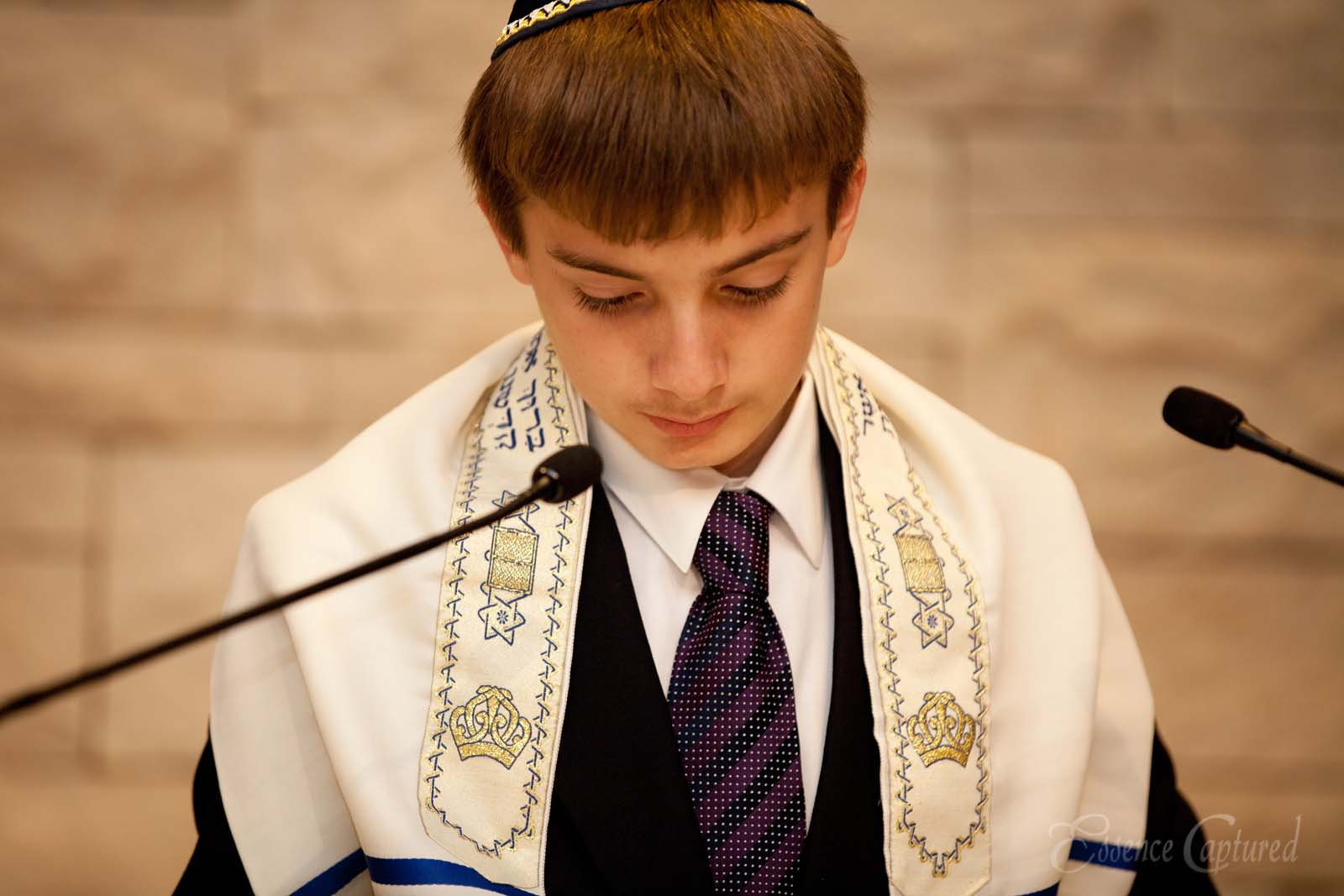Bar Mitzvah boy at podium in synagogue