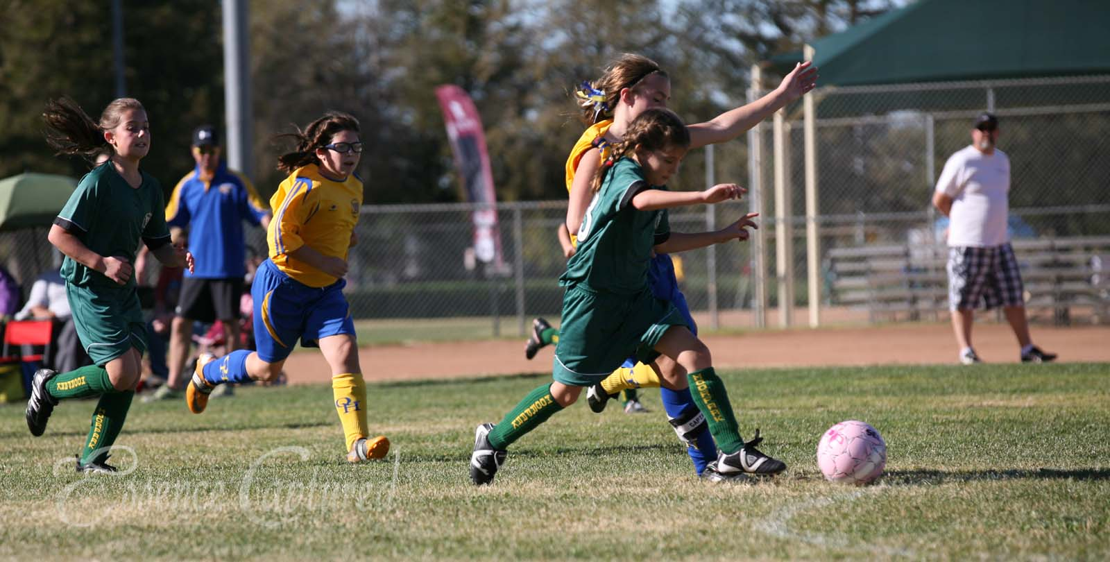 girls play soccer green jersey Conejo Valley