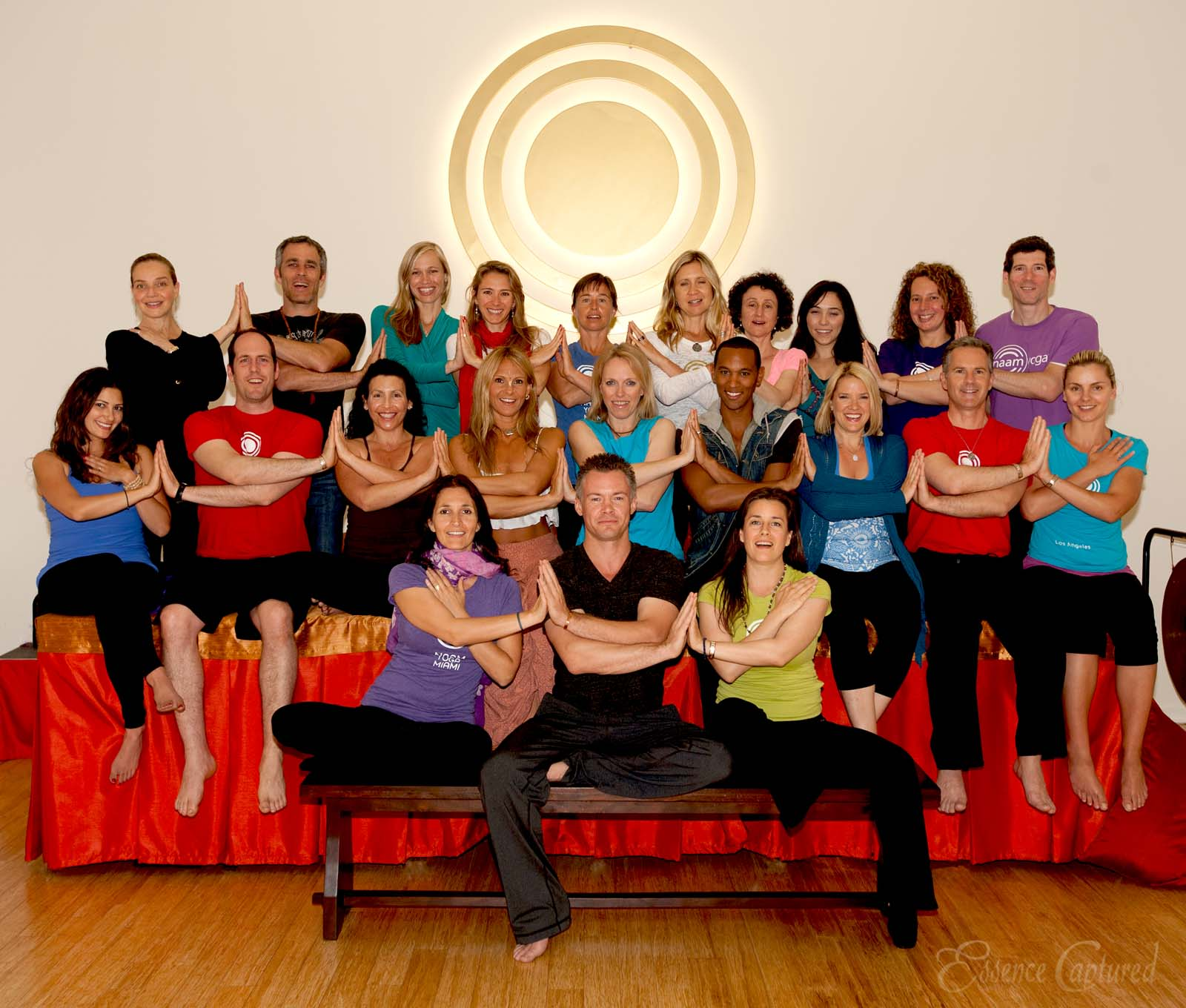 Naam Yoga Teachers group photo arms across chest hands touch each other