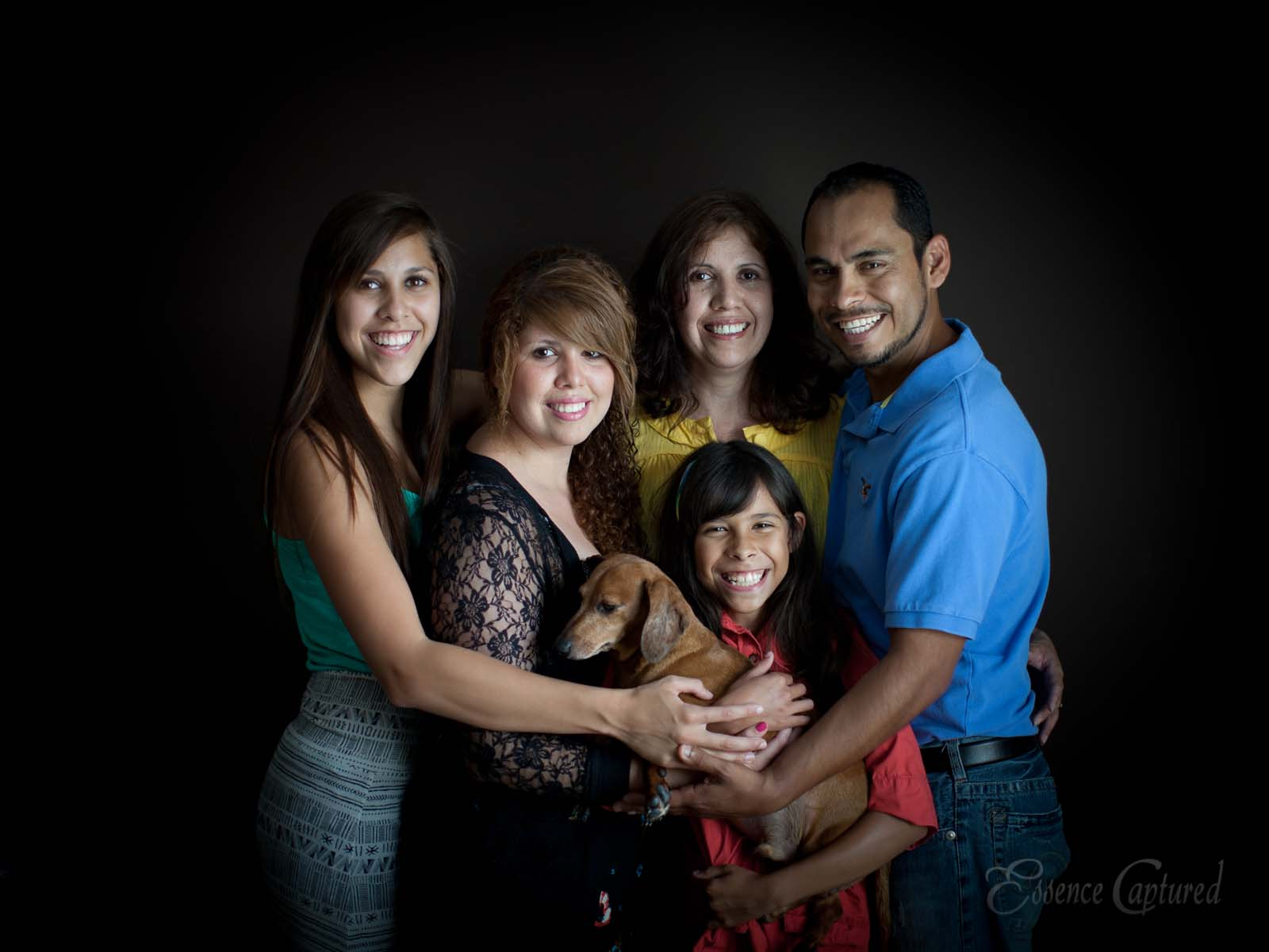 family of 5 plus dog portrait with dark backdrop