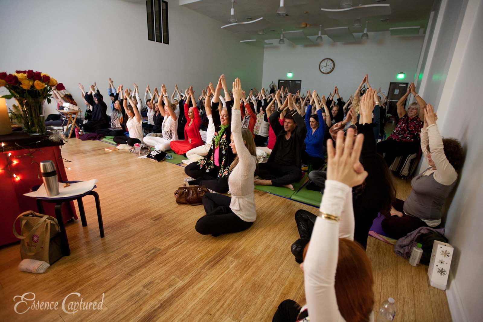 Naam Yoga L.A. New Years Eve event group yoga prayer shakti naam prayer hands high over head