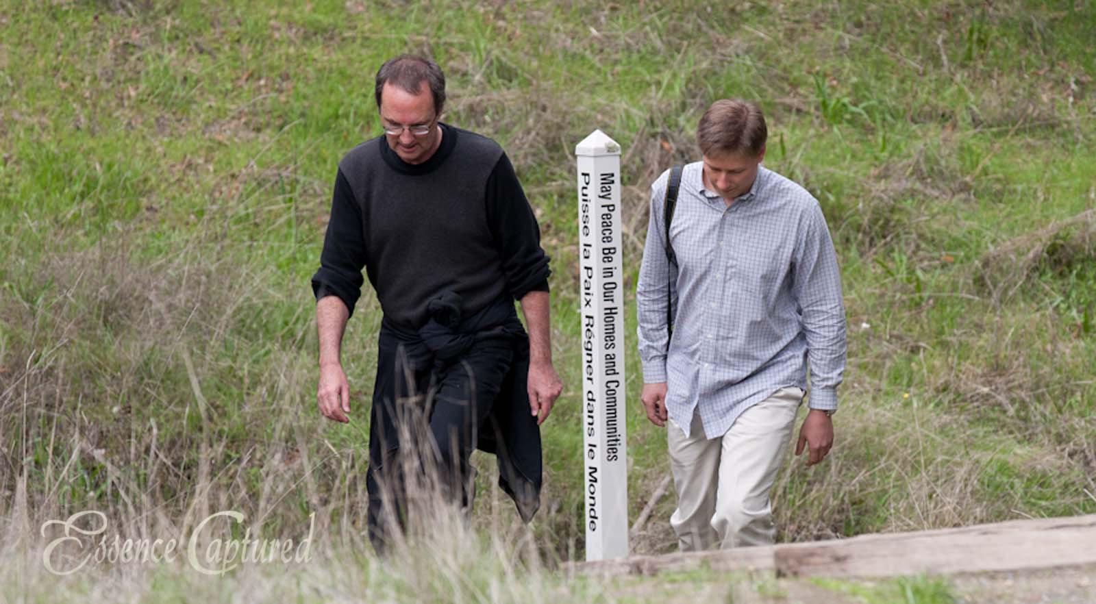 two men walking on trail at Earthrise may peace be in our homes and communities