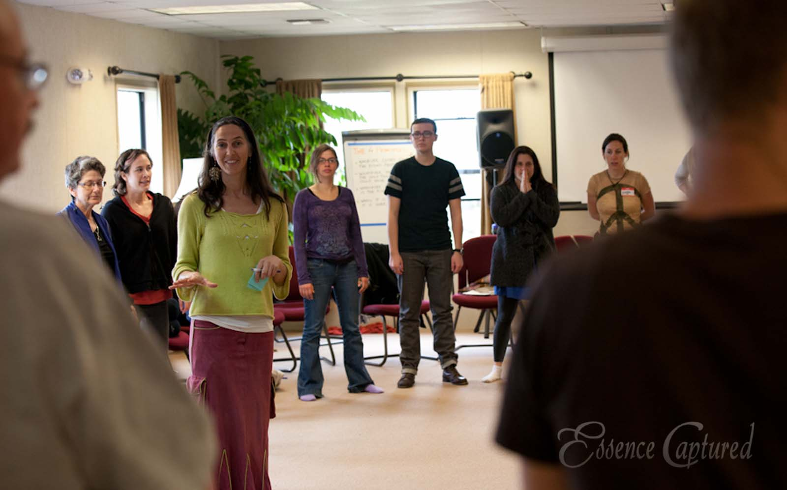 art of hosting training woman gives direction to group in circle