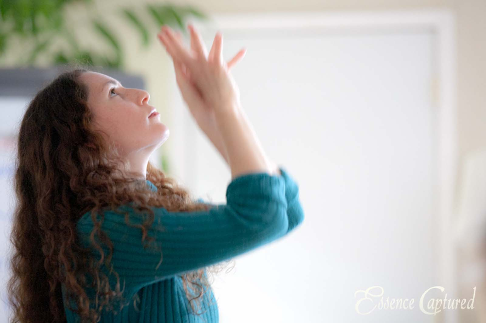 woman in interpretive dance free movement hands upward