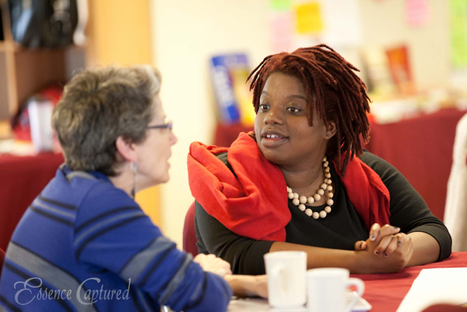 two women talking at conference
