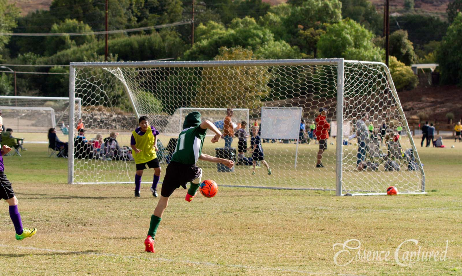 boys soccer green jersey striker at goal Conejo Valley