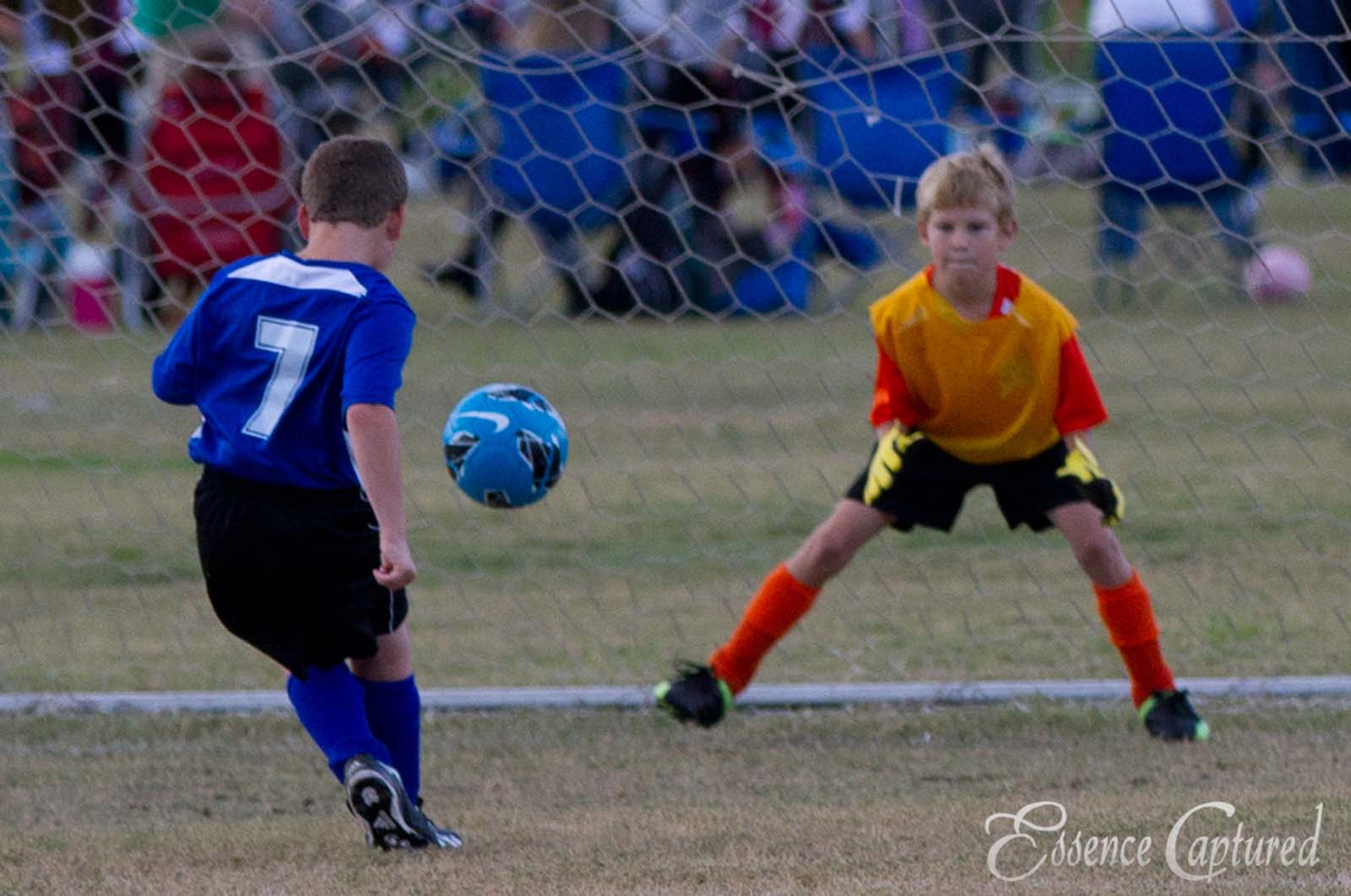 boys shooting on soccer goalie blue jersey Conejo Valley
