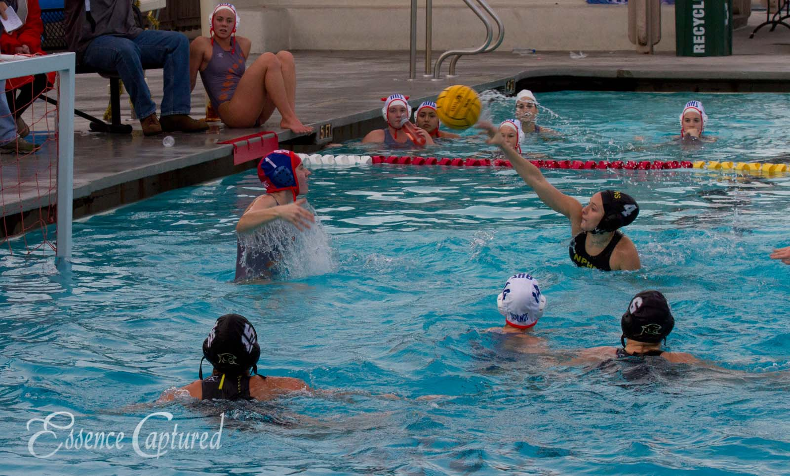 girls water polo action shooting on goal