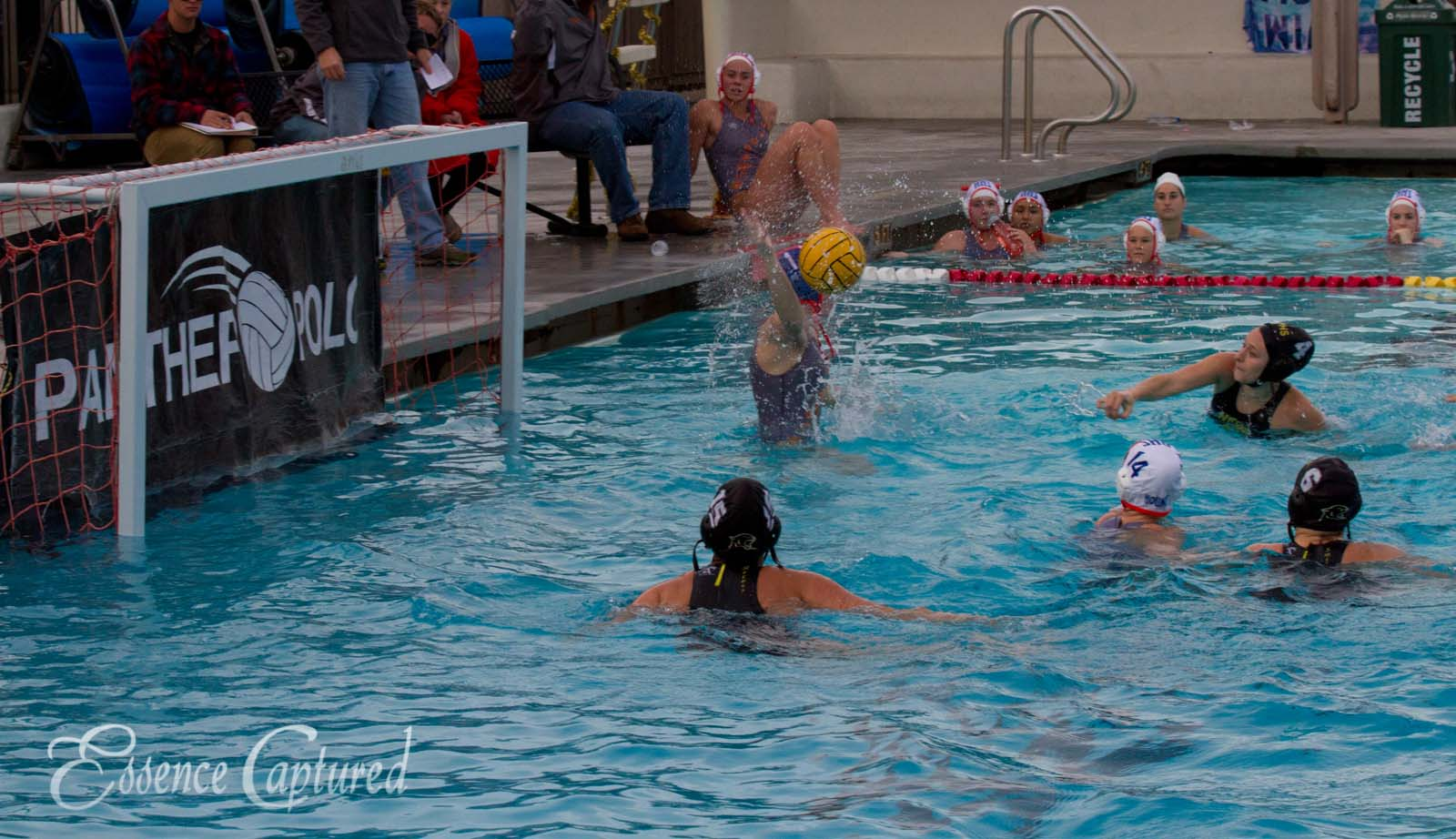 girls water polo goalie blocks shot