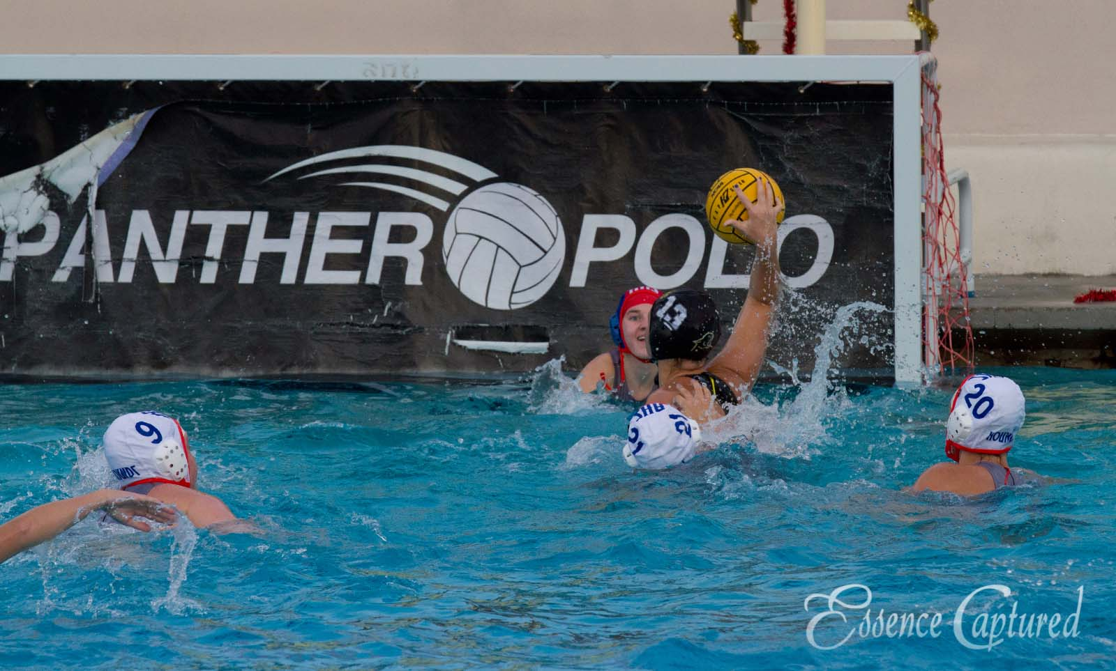 girls water polo player attacking goal