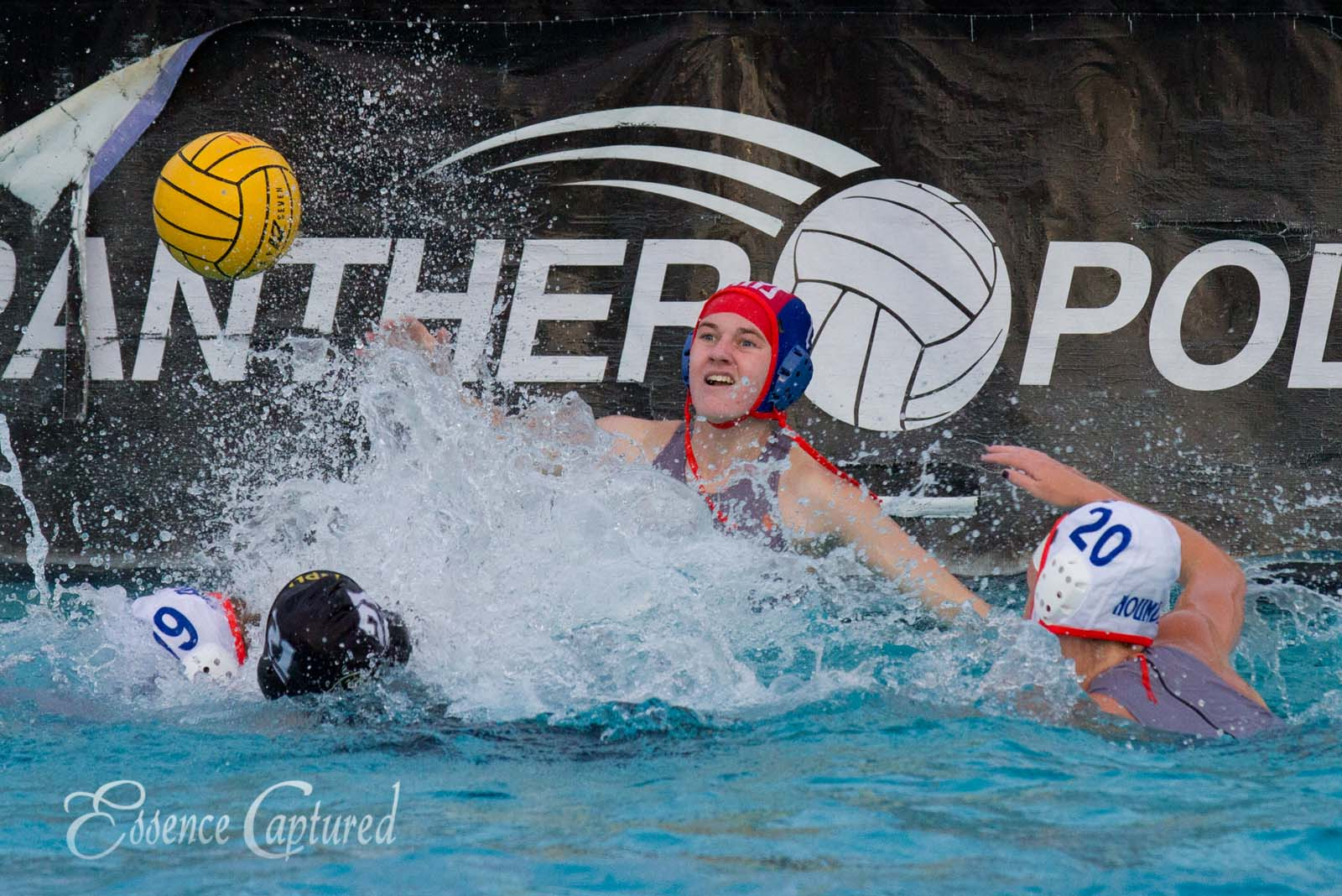 girls water polo shooting on goal