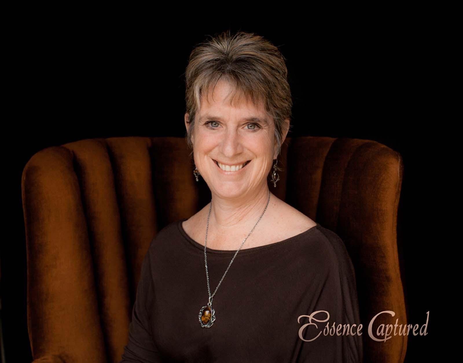 female portrait short hair elegant browns and bronze colors