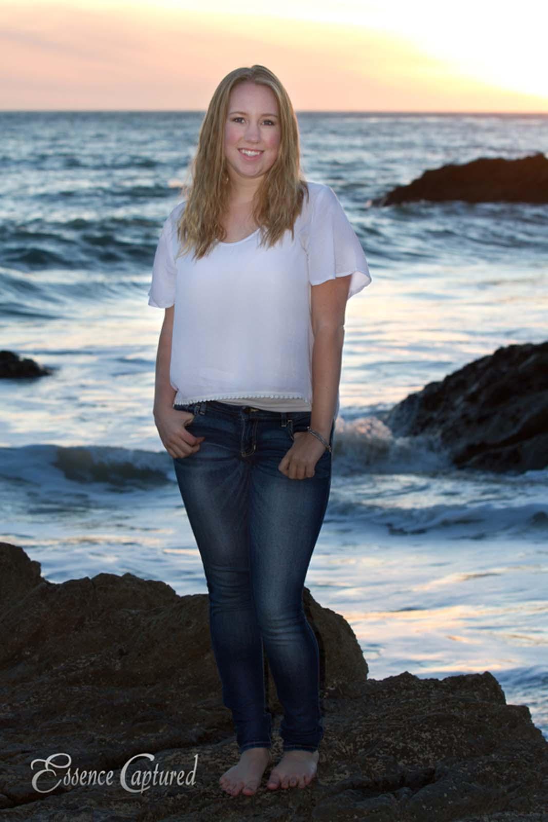 female high school senior portrait ocean backdrop white shirt blue jeans