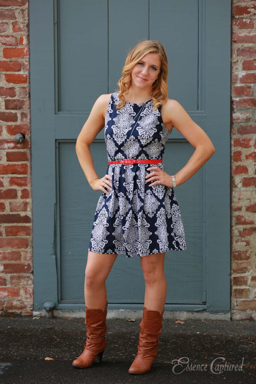 female high school senior portrait blue print dress long blonde hair hands on hips