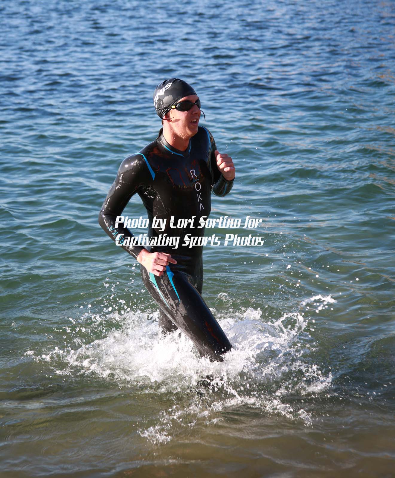triathlete exiting water with splash