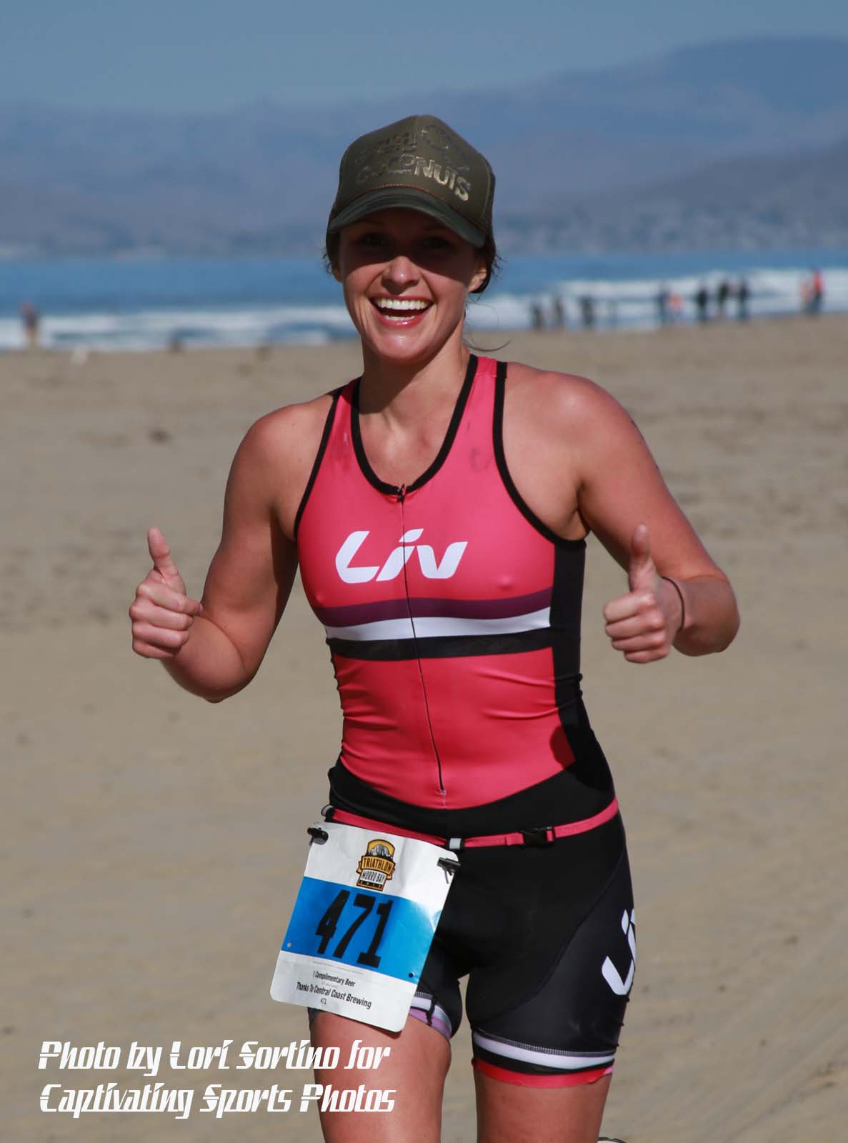 female triathlete running on beach pink shirt Morro Bay Tri