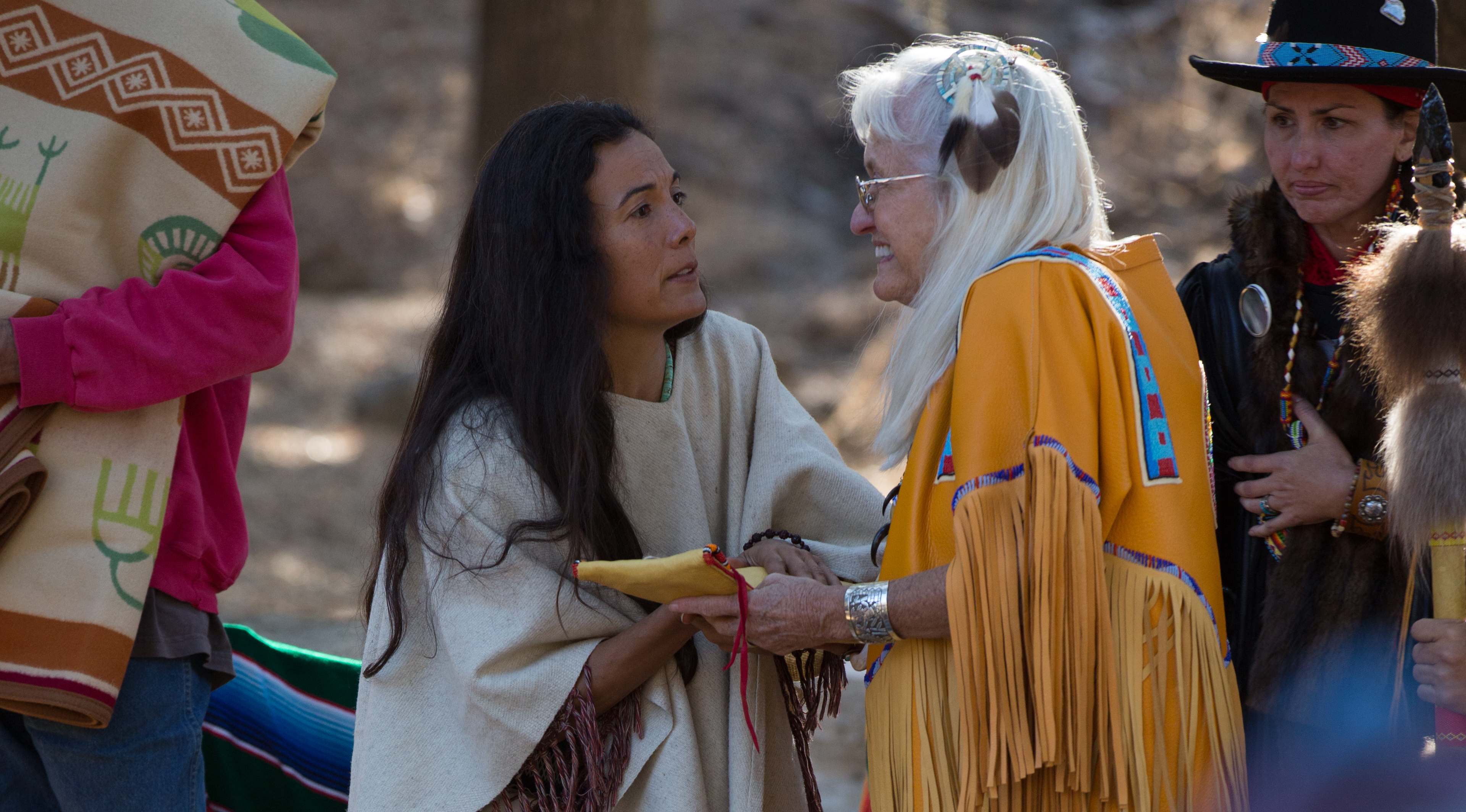 sister giving gift to elder at Long Dance Native American Ceremony