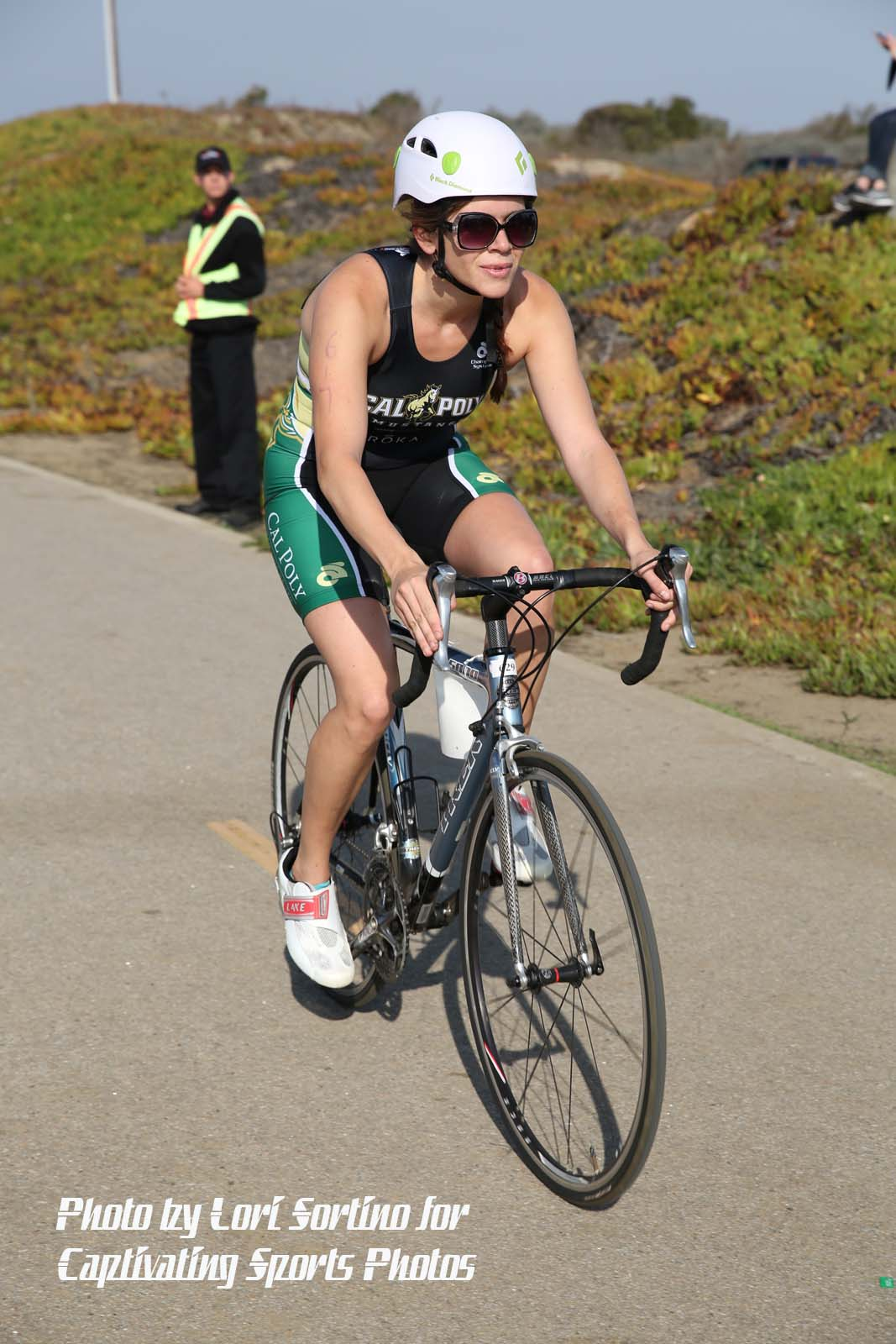female triathlete cycling white helmet