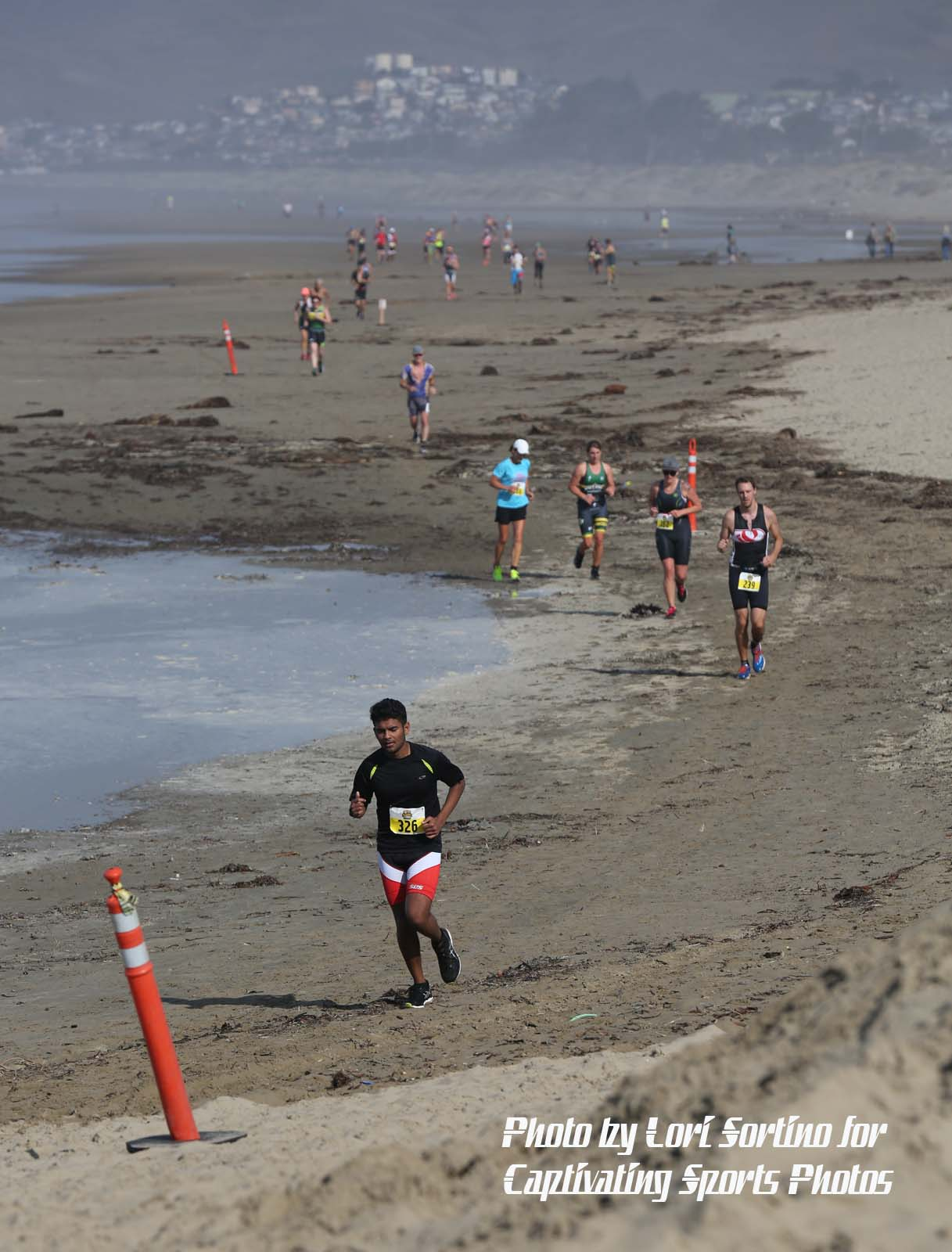 Morro Bay Tri runners on beach