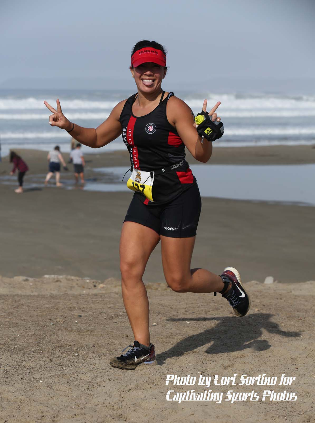 female triathlete runner peace hands red had smiling Morro Bay Tri