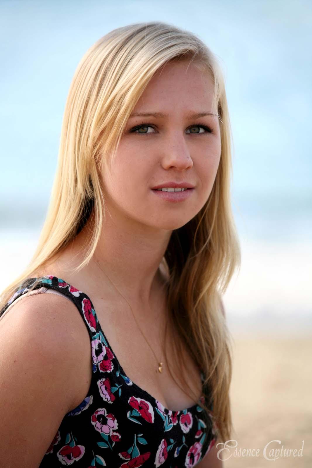 female high school senior portrait long blonde hair beach setting
