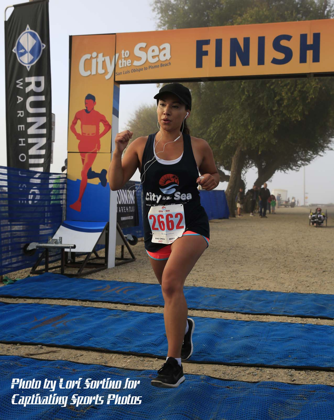 female finish line City to Sea running race Shell Beach