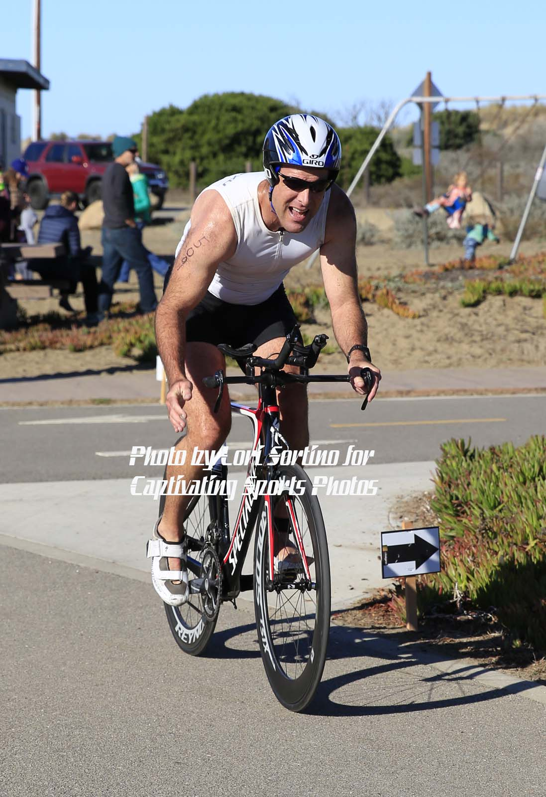 male triathlete cycling Morro Bay Tri