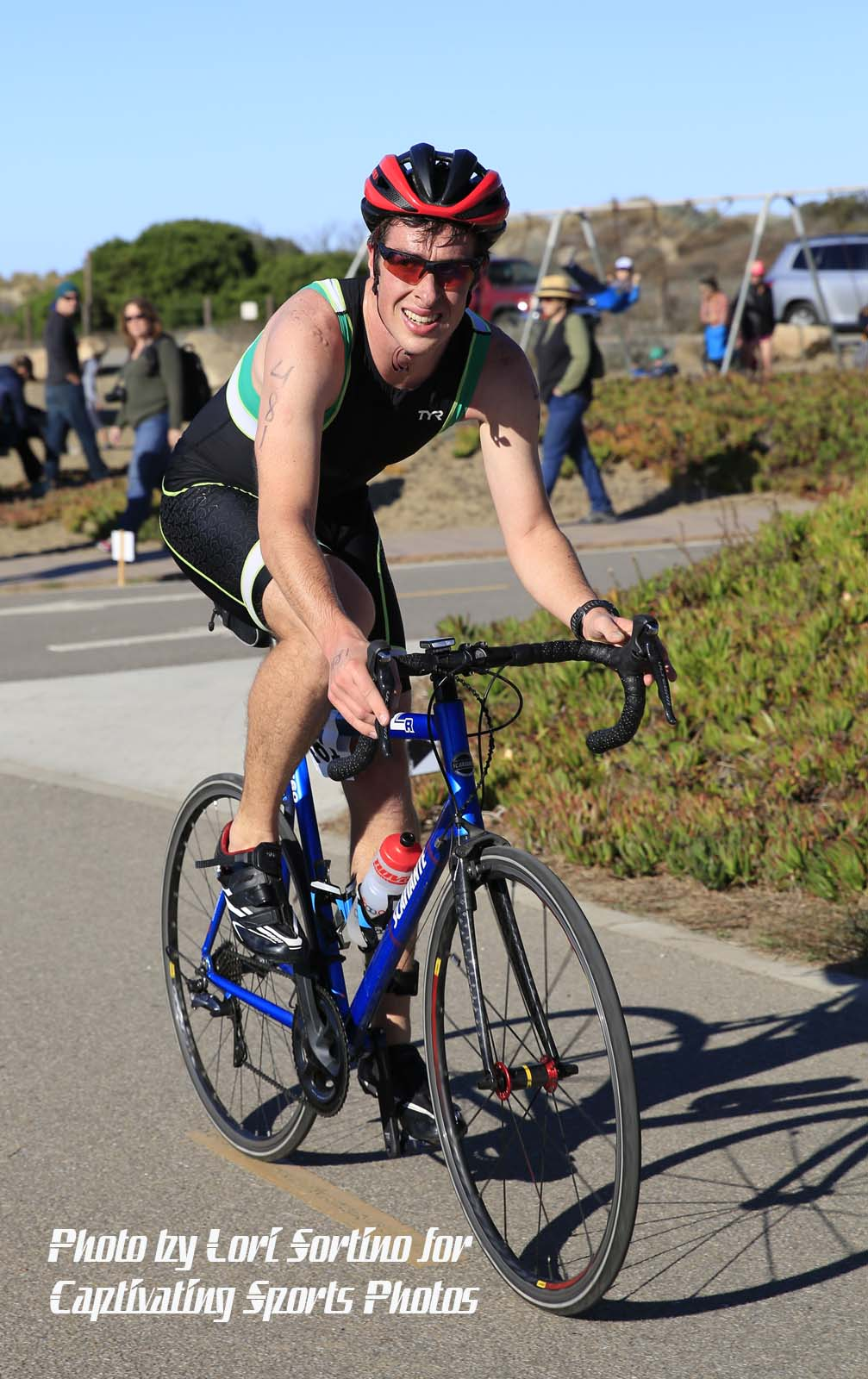 female triathlete cycling Morro Bay Tri
