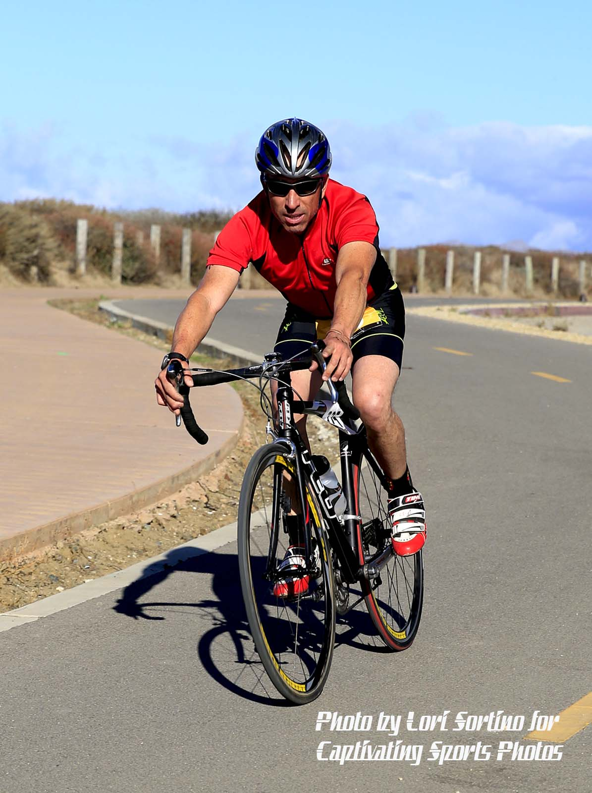 male triathlete cycling red shirt Morro Bay Tri