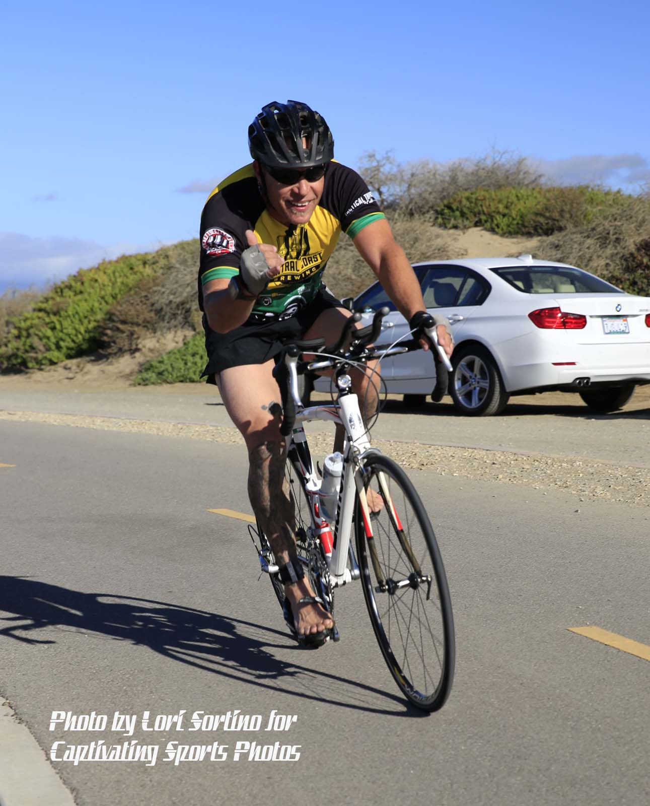 male triathlete cycling barefoot Morro Bay Tri