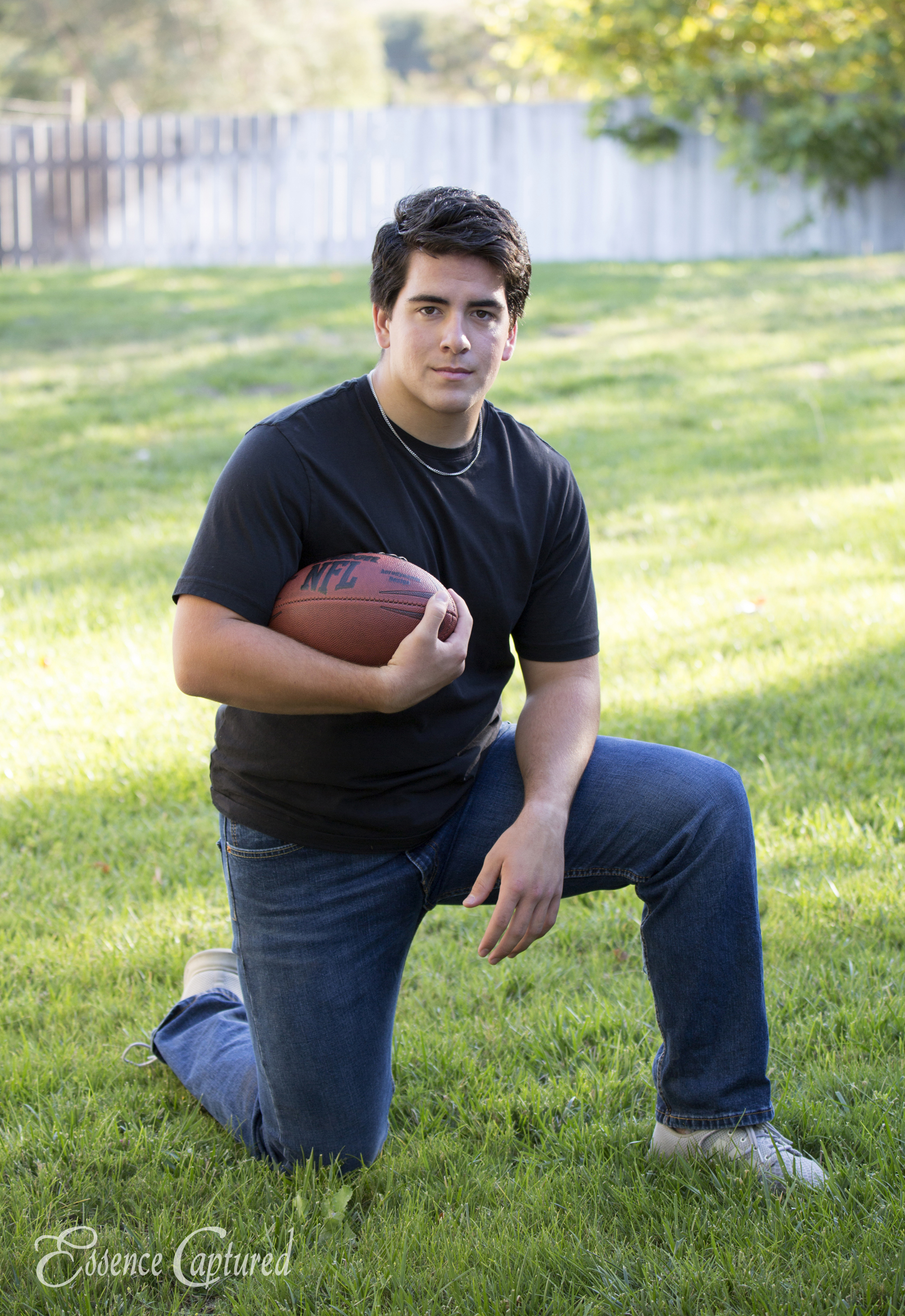 male holding football