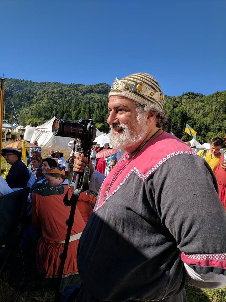 man in costume with camera